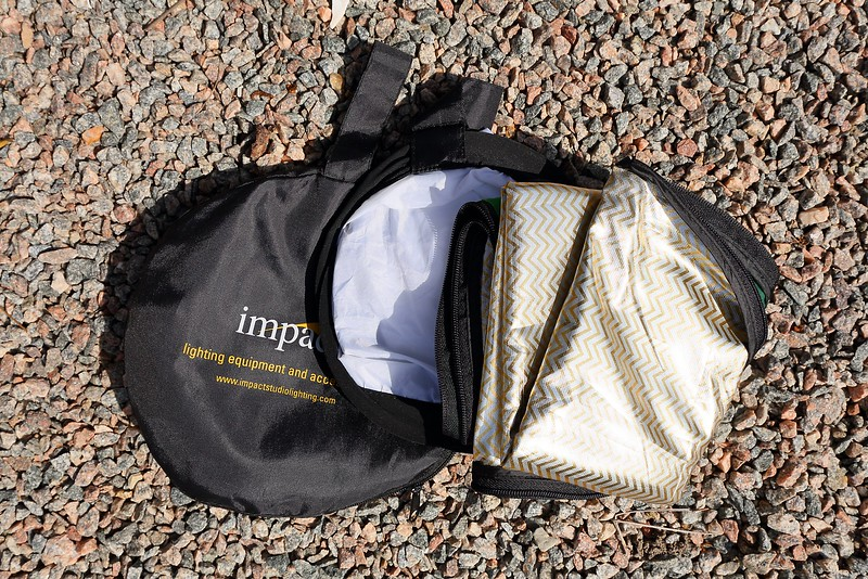 """Impact 5-1 32"""" photo disc multi-sided covering folded on top of the actual disc, itself on top of the storage bag."""