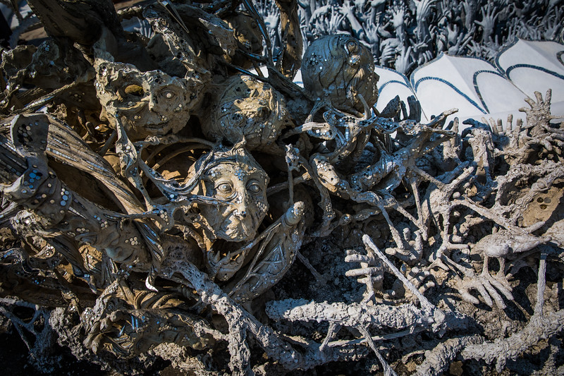 """artistic sculptures reminiscent of """"Dante's Inferno"""", forming a moat around the White Temple of Chiang Rai"""