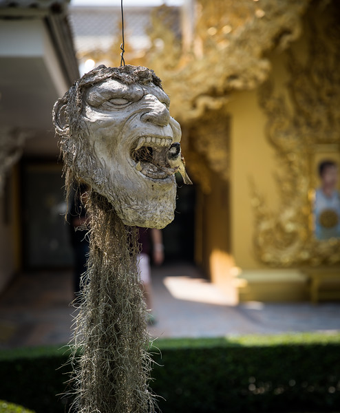 the White Temple of Chiang Rai has many sculptures of super heroes, villains, and monsters' heads hanging from the trees surrounding it