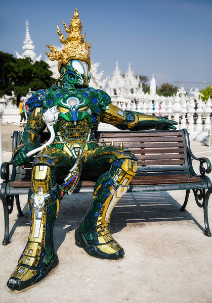 an artistic statue of a super hero outside of the White Temple of Chiang Rai