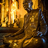 a statue of a monk in a Buddhist monastery