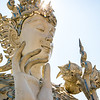 one of the many decorative statues found in and around the White Temple of Chiang Rai