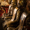 bronze monk statues decorating a Buddhist temple