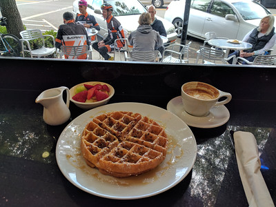 Enjoying a breakfast waffle at Red Berry Coffee Bar.