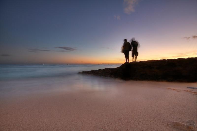 Waikiki Beach Silhouettes at Sunset - Honolulu, Hawaii