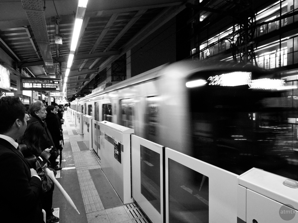 In coming, train station - Tokyo, Japan