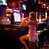 Waitress in a quiet bar - Austin, Texas