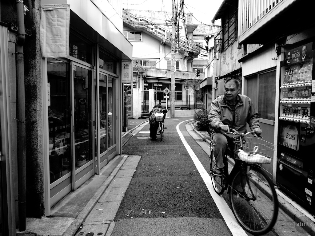 Cyclists Passing - Tokyo, Japan