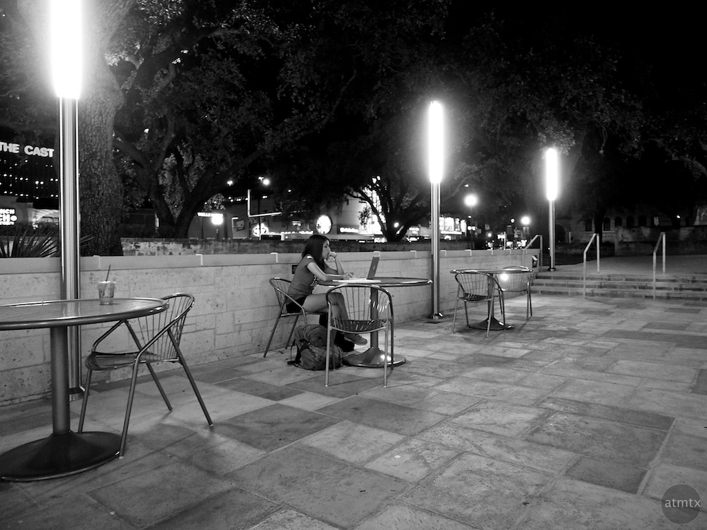 Studying by the glow of light sticks, University of Texas - Austin, Texas