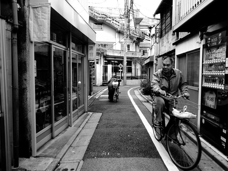 Cyclists Passing - Tokyo, Japan