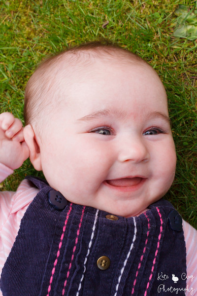 Baby girl smiling on the lawn, Musselburgh.