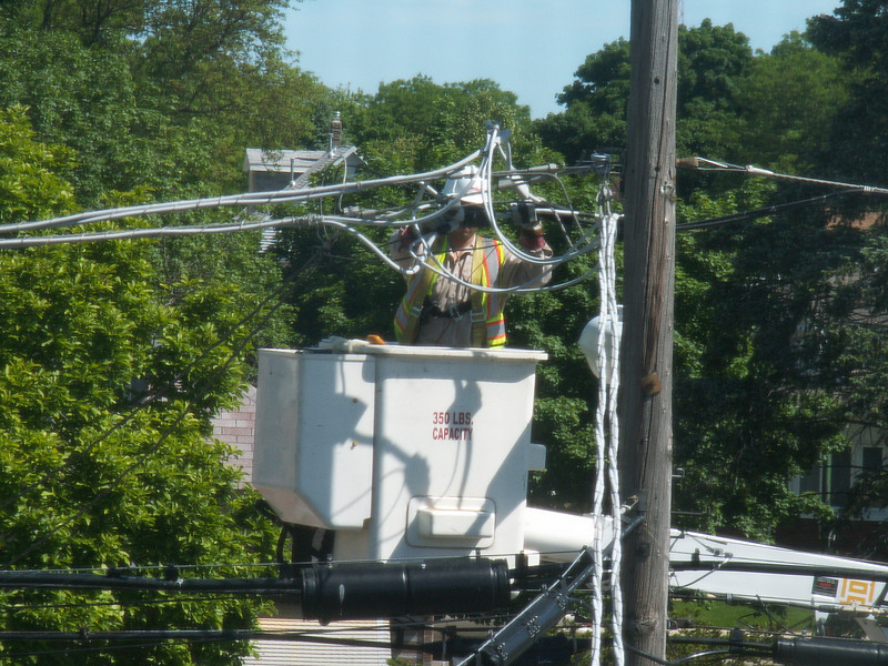 """Illinois ComEd technician works on the power lines feeding my house. Article: <a href=""""http://www.windypundit.com/archives/2005/06/vac_the_final_c.html"""">VAC, The Final Chapter</a>"""