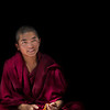 Light at Sera Monastery<br /> <br /> I met this friendly little Tibetan Monk at the Sera Monastery during my short trip. He was in the middle of a courtyard full of monks who were engaged in the famous Monk Debates, which are a sort of verbal sparring match used as a method for teaching monks about Buddhism. The basic premise is that one monk asks a questions and the other has a limited amount of time to answer. It gets exciting though because the monk asking the questions makes martial art-like gestures while the monk sitting on the floor tries to retort before he gets a figurative karate chop to the head. The questions are all relating to the teachings of Buddha and are meant to test their knowledge. It was fun to watch these, otherwise peaceful dudes, let out some steam with all their crazy gestures and yelling about.<br /> <br /> Why the heck did I process this photo so that the little monk is shrouded in darkness? Well, just look at the relentless peace and optimism emanating from his face, despite of everything going on out there. It just seemed appropriate that he would give off light in the darkness.