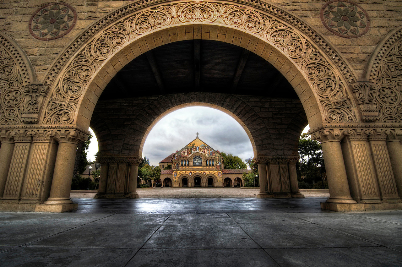 Palace Gateway  There is something regal about Stanford's campus.  Every time I visit, I feel like a country bumpkin who managed to sneak into the palace by hiding in the hay cart.  I keep waiting for the palace guards to decent upon me and throw me in the dungeon.  Well, until that day comes, I am happy to roam around and take pictures of this beautiful campus.