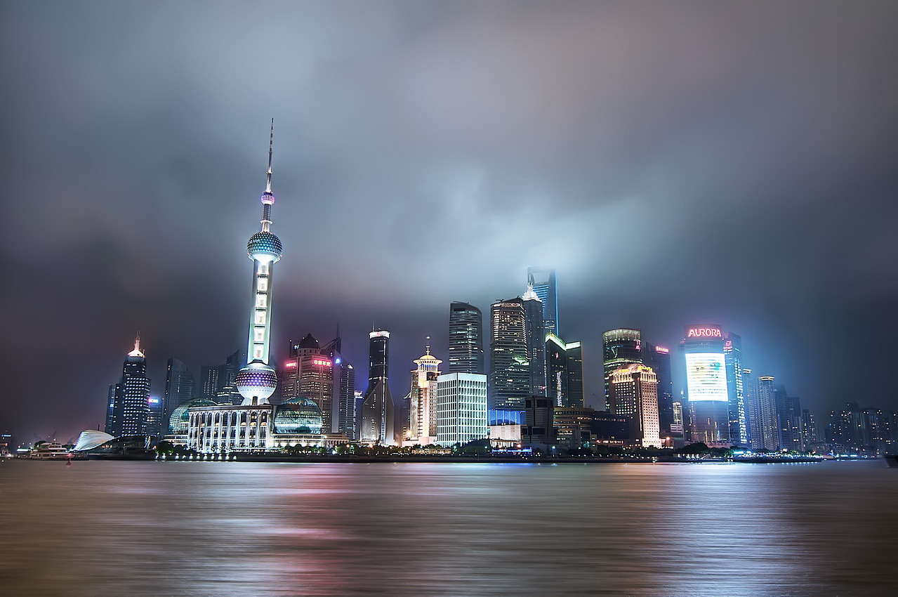 Shanghai Nights  I have had a few opportunities to visit Shanghai and I am never disapointed with the sights.  This is a view the Pudong District from across the river.  It was late and I had been walking all night and was about to call it a day when I came across this view.  I setup my rig and took a few shots right before they literally shut off the lights.  I got an image of some technician in a dingy little room throwing a switch and laughing to himself in the dark.  I looked around wondering if someone was playing a practical joke on me, but I guess there is no need to show off after 11pm.