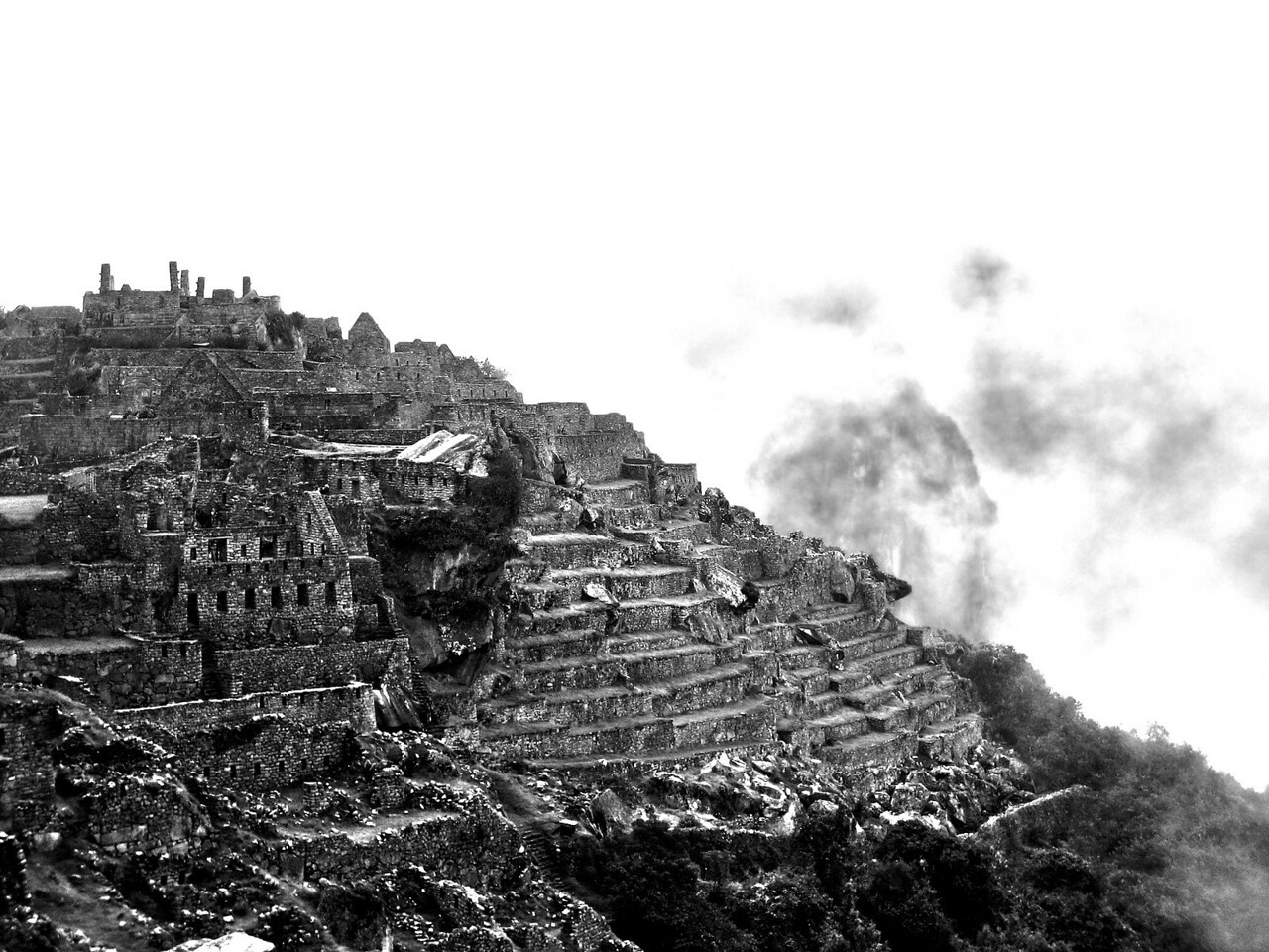 Ancient Machu Picchu  There are certain places in the world that are a requisite visit for any self-respectable traveler. Machu Picchu is one of those places. I am sure you have seen the typical pictures of the ruins nestled at the top of an Andean mountain, so I offer you a different perspective of this gorgeous vestige of civilization.  I was in the middle of a two month trip through South America and had recently met up with my two brothers in Ecuador before flying into Cusco to begin the four-day Inca trail hike. We had arrived the same day that we were to start the hike and the only one who was prepared for the sub-zero temperatures was my older brother. In true style, my younger brother and I were just relying heavily on luck and the generosity of others. =) There is a lot more to the story, including a doggie peeing on us while we slept, a whirlwind romance with a llama and some unfortunate emergency defecation on the Andes. It is just not a good trip unless you get a good poopie story out of it. Wait until you hear my Bolivia story … but, let's just leave that for another time. Needless to say we were the last ones to start the hike and the first ones to make the manly entrance into Machu Picchu. We pride ourselves on being stubbornly determined about these things.  When we arrived we were greeted by a thick cover of fog that obscured the entire site. It might as well have been Martha Stewart's vineyard for all we were able to discern from our vantage point. We had to wait until the fog burned off a bit so we took the opportunity to video tape ourselves making fools of … ourselves (and thus the Machu Picchu crab walk was born). When we were finally able to run around the ruins we quickly got lost in a labyrinth of stone passages and tried to soak it all in. You end up floating around from one place to the next imagining what the ancient Incas must have been like and what it must have felt like to be the race who lived in a city so close to the heavens. Not e