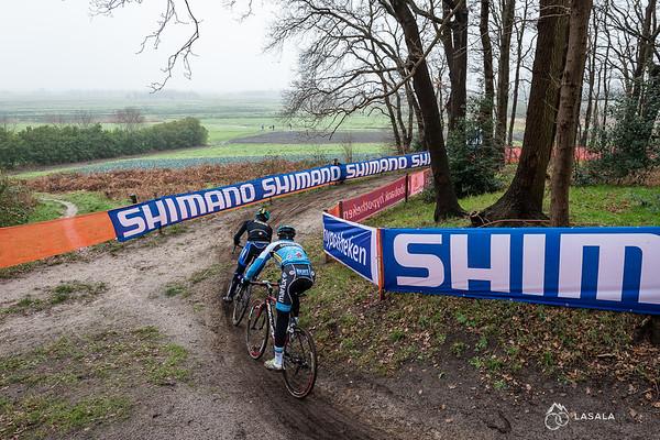 2 riders railing a turn on the pre-ride at the Hoogerheide Cyclo-cross World Cup on January 23, 2016 in Hoogerheide, The Netherlands. Photo: Matthew Lasala