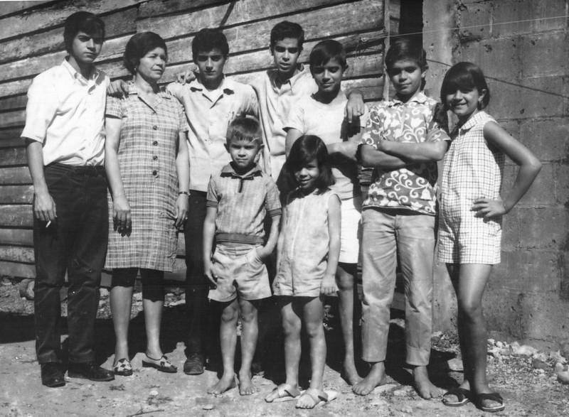 Family portrait of my father Oscar with my Abuela Blanca and all his brothers and sisters, minus one who wasn't born yet. My abuela had nine children.