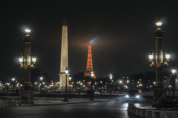 Vertical shapes in Paris, France, include the Obelisk of Luxor and the Eiffel Tower. September, 2011.