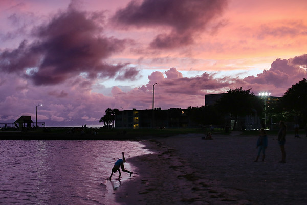 Purple skies are the result of dissipating storm clouds and sunset. Gulfport Beach, July 5, 2018.