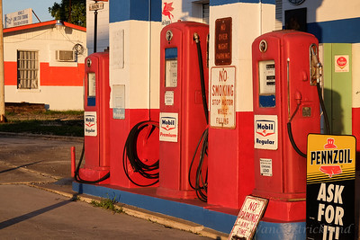 Old gas pumps in the morning light.
