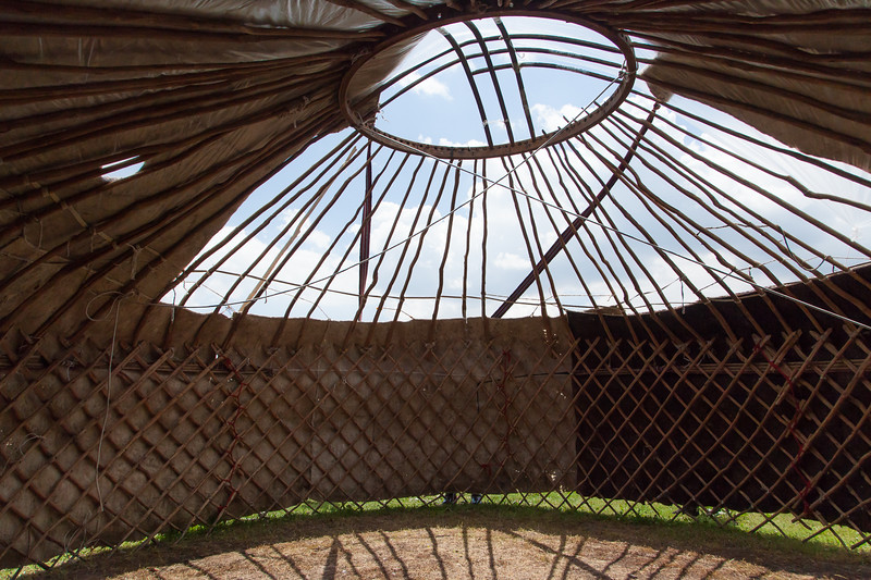 Traditional yurts consist of an expanding wooden circular frame carrying a felt cover. The felt is made from the wool of the flocks of sheep. The timber to make the external structure is not to be found on the treeless steppes, and must be obtained by trade in the valleys below.