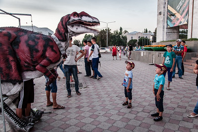 Ala-Too Square, main square in Bishkek, Kyrgyzstan. The square is full of small attractions for the kids, for example this dinosaur, that manages to capture kids' attention.
