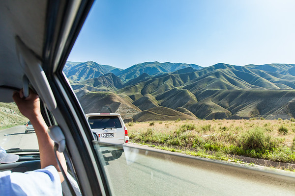 Our convoy moving through Kyrgyzstan. 4x4 vehicles are necessary given the road conditions.
