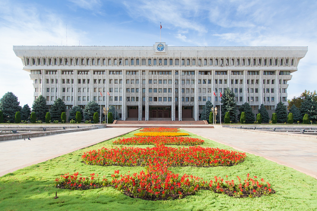 The White House, the presidential office building in the capital city of Kyrgyzstan, Bishkek. The White House was the site of riots during both the 2005 Tulip Revolution and the 2010 Kyrgyzstani riots. During the 2010 riots a fire broke out and damaged portions of the building and destroyed the hard copies of many government records. Built in Stalinist modern style.