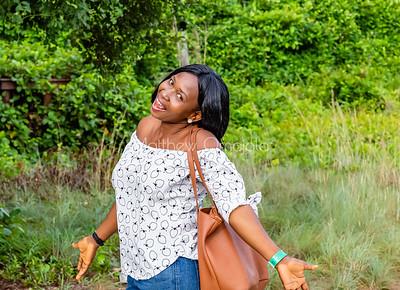 Happy pretty female, woman girl fashionable Nigerian tourist Lekki Conservation Center Lagos Nigeria