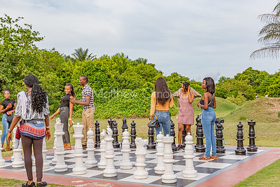 Visitors playing with floor Chess game Lekki Conservation Center Lagos Nigeria West Africa.