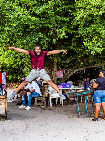 Happy male Nigerian black tourist jumping Lekki Conservation Center Lekki Lagos Nigeria.
