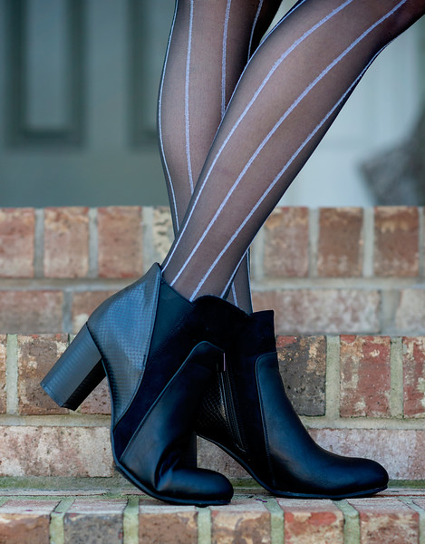 Debbie faux leather and faux suede heeled bootie $44.00