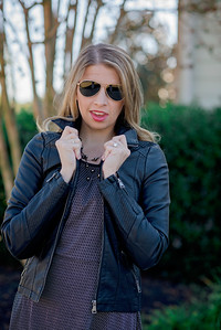 faux leather moto jacket with knit sides in black $59.00