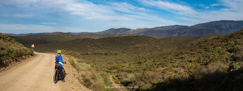 eBiking (mountain biking) on Strykhoogte Pass and the Riviersonderend Mountains in the background. McGregor. Western Cape. South Africa