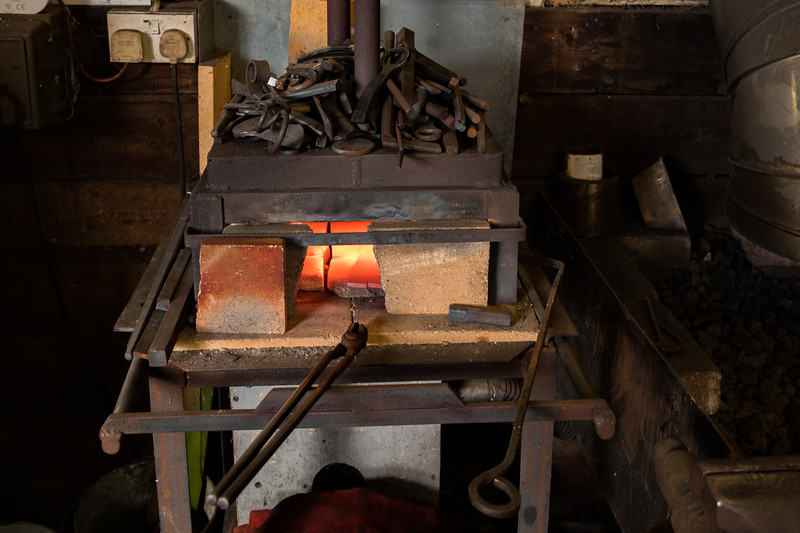 He starts by heating up some mild steel cut to specific sizes