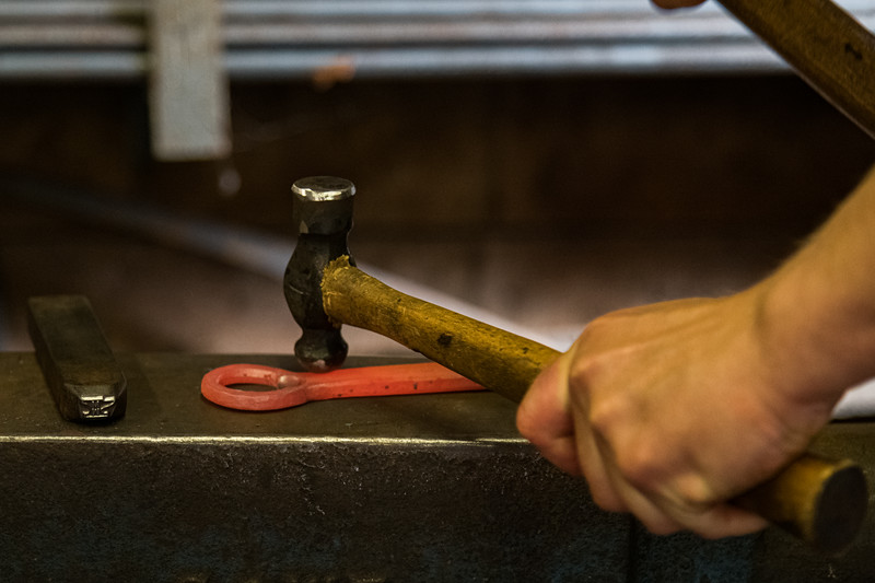 More heat and using the other side of the hammer to create the tab that fits the cap.