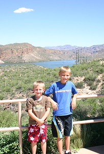 Travis and Andrew stand in front of Canyon Lake at a viewing point along the road.