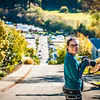 Erica Jacques smiles as she turns to look at the camera atop Baldwin street, the world's steepest street in north Dunedin, Otago New Zealand on Friday afternoon May 6, 2016. (©Zachary A.M. Kelly 2016)
