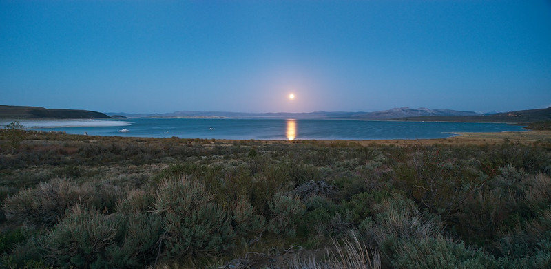 "MEA CULPA - 20 February 2014<br /> <br /> Moonrise on Mono Lake - Lee Vining, California<br /> <br /> I've flown the T-38 off and on now for 25 years. In that time, I've collected about 1500 hours and about as many sorties.  Lots of those hours were spent giving instruction to someone new to the plane.  By any measure, I'm pretty experienced and certainly don't have room for excuses if things mess up.  As much as I might wish otherwise, experience doesn't prevent me from screwing up, ever.  Last week I over-sped my flaps while on a touch-n-go.  I exceeded the flap limit by three knots.  It wasn't a student pilot's fault.  It was me on the controls doing something I'd done literally thousands and thousands of times before.  While we might think of these types of things in the domain of less experienced aviators and not so much associated with old heads like me, I did it clear as day.  <br /> <br /> I was giving a new Flight Test Engineer her orientation flight in the T-38.  It was her first flight in a high performance aircraft.  She had already finished the Airmanship program, which was five flights in a Cessna 172.  Our mission was about taking her exposure up a notch.  This was her first flight all alone in the backseat, complete with helmet, mask, and g-suit.  It's a big transition for most folks because the environment is so different than anything they have done before.  Between the helmet and mask making even the least claustrophobic person feel cramped, the g-suit squeezing their guts, and the act of flying upside down, lots of new FTE's have a terrible time on their first flight.  Nope, not Scrappy.  She did fantastically well, which only makes what happened later more frustrating.<br /> <br /> We finished the flight out in the area.  Scrappy was great.  Now, back in the pattern, I was talking through all the mental processes that should be running through her head — where we were, what the plane was going to do next, watching the fuel, the speed, and knowing how fast we were supposed to be while in the pattern.  It was all normal stuff.  As is our procedure, I did a full-flap touch-n-go, which worked out beautifully.  As is also our procedure, I repositioned the flaps to 60% while accelerating for the next take-off.  After being airborne, I raised the gear at the right time, then promptly forgot the flaps.  At least I forgot about them until it was three knots too late.<br /> <br /> In case you haven't flown the T-38 or any high-performance aircraft, let me explain: in the pattern, you never directly reference checklists.  You don't look and read what you're supposed to do.  You just do.  Time is better spent looking out the window than spent in-cockpit staring at a procedure you are so familiar with.  Of course, something happened and I forgot the dang flaps.<br /> <br /> The real impact of hurting the plane like this is it's ""downed"" until the flap mechanism is checked.  As is the case 99.9% of the time, maintenance found nothing wrong, which doesn't make what I did (or didn't do) any easier to accept.  Because the plane was ""down"" for two days, we lost a day of sorties that plane could have flown.  This has the biggest impact, since our Senior class is a week and half behind schedule and not getting much better.<br /> <br /> Scrappy - I didn't have to teach her much.  She new exactly what happened.  In fact, as I pulled the throttles, just too late, she was trying to warn me from the backseat but couldn't think of the words.  In debrief, she said she noticed the overspeed about the same time I did.  That meant a couple of things to me: first, that she knew what the limits were, which she's not required to know at this stage in the curriculum; second, she was watching for it but wasn't quite there to really save the day.  Both of these tell me she's well on her way to being a great FTE.  <br /> <br /> There's not much more to tell.  As we say, it was pure buffoonery.  No one wants to be associated with such things.  I certainly don't.  But, let me point out to any of you new or old aviators: if you think it can't happen to you, think again.  No one is exempt from making mistakes. I was reminded of that first hand a few days ago.  <br /> <br /> Cheers<br /> <br /> Tom"