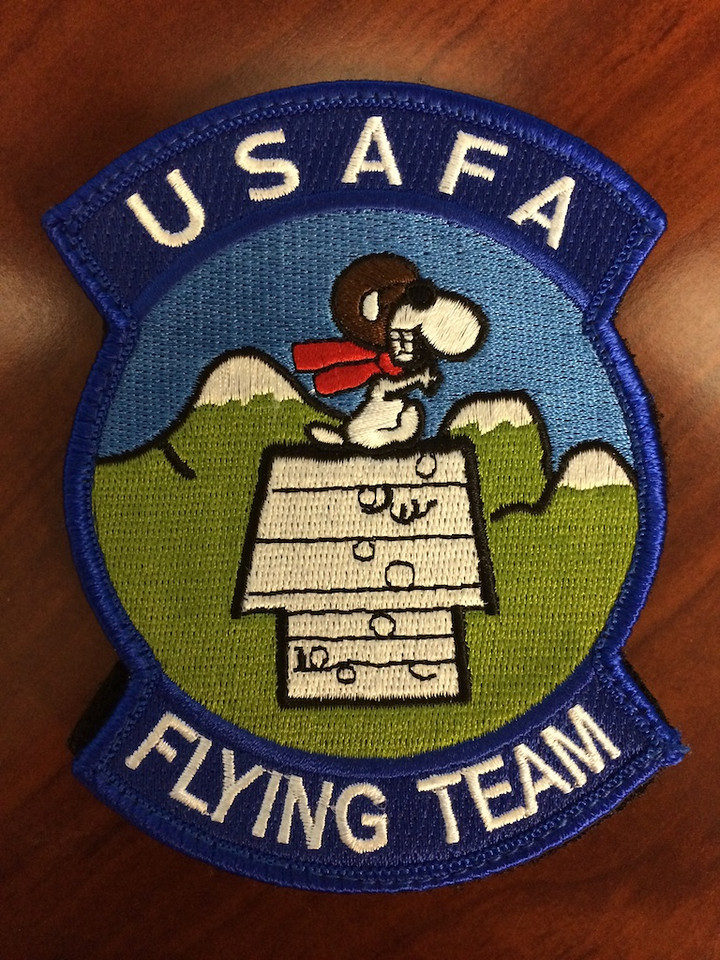 """USAFA Flying Team Patch - Edwards AFB, California<br /> __________<br /> <br /> On this day, I get on the end of the runway with my cadet safety strapped into the backseat. The kick and speed rush associated with escaping the runway at 165 KTS is all there. I make a slight turn out of traffic towards the fat part of our airspace, which for me is all pretty normal stuff. As we climb away from the ground at a good rate, my backseater pipes up, """"Sir, this is probably the coolest thing I have ever done in my life!""""  All he needed to add was a cursory, """"Yee haw!"""" to really state what he was feeling.<br /> <br /> We finished the mission. His grin was a mile wide the whole time we walked back to TPS. Afterwards, he and a couple other cadets I flew with that week gave me a little memento of their visit—the patch you see here. <br /> <br /> I'm glad I have reminders like these. They ground me. There's always the risk of being overly full of oneself. Also, just when I might think my best days are over, there are little events like this to show me that's not so.<br /> <br /> Cheers<br /> <br /> Tom"""