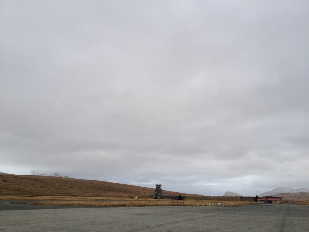 Control Tower - Adak, Alaska<br /> <br /> Fast forward six months to my first operational assignment at Kadena Air Base in Okinawa, Japan. Arriving there was another opportunity for being named. You see, the F-15 community named all new arrivals in their squadron regardless of how long they had a name from before. Everyone went through the gauntlet on a Friday afternoon naming session. Most of the newly arrived old heads kept their names. With the new guys like me, anything was possible. <br /> <br /> Of course, nothing happens without a story. The more epic the story the better. As a result, most folks in my new squadron were named after they went on their first squadron deployment. The pressure of deployments was always a ripe opportunity for good stories. In my case, that didn't matter. For me, it was all about how my call sign sounded. <br /> <br /> There were lots of reasons why people got their names. We weren't always insensitive to one's desires, though saying out loud you liked a name tended to get the name erased from the candidate list. Sometimes names were rejected because they failed the mother test--i.e., would your mom be too embarrassed to hear you called by that name at a Christmas family gathering? We even considered what other aviators think. When flying air-to-air training missions, it was always better to have a wingman with a name striking fear in the heart of your adversaries--e.g., Pounder--versus something that invoked a laugh--e.g., Twinkie. <br /> <br /> My naming was done in our squadron bar, aka, The Zipper. About the size of a big bedroom, it was quite a feat to pack the whole squadron in there. Imagine a place with sandbags on the wall, sand painted into the floor to improve traction for Friday night activities. A bar, a cooler, no chairs or stools--who's going to sit in a bar, after all? A parachute hanging in the corner. In another corner was a table with one chair on top for the namee. <br /> <br /> When I was up there, the crowd wa