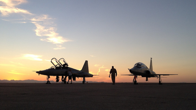 "WHAT MOTIVATES PEOPLE - 28 February 2013  T-38's at Sunrise - Pheonix Williams Gateway, Arizona  <a href=""http://karlenepetitt.blogspot.com/2013/02/what-motivates-people.html?m=1"">  Link To Original Article On ""Flight To Success""</a>   I have a co-worker who is in charge of our flight operation - he's our Operation Officer, for those that know USAF vernacular. He's a great kid (everyone is a kid who is more than 10 years younger than I), and an extraordinarily good aviator in my book. In his time in the USAF, he earned many accolades, graduated at the top of several of histraining programs, and performed awesomely (is that a word?) in combat. I think his best characteristic is that he has a down to earth life philosophy. How do I know any of this? When you're flying across the country in a Beech 1900--i.e. C-12J or stretch KingAir--you have lots of dead time to talk about things.  One topic we covered was what motivated him to do well in pilot training. He eventually simplified his philosophy to this: ""I just didn't want to suck. No kidding, when I finally got to pilot training I didn't want to be known as that guy who sucked."" He told me one story about his early days in pilot training: Instructors can be grueling.  This can be personality-dependent, meaning some instructors are more ""intense"" than others. A standard USAF pilot training classroom is a big open room with about 10 little tables set up in a circle forming a perimeter around the room. On the outside of the circle sits an instructor. On the inside are his students, usually two. Most classes have about 20 students, two per table. An instructor is responsible for most of his student's training, which includes grilling them with whatever question he thinks of. Of course, the situation is wide open. Everyone in the room can see or hear what's going on.  Early in his training, he was suffering through one of these grilling sessions. His instructor was really giving it to him. The questioning even goes off the beaten path into regulations students are responsible for yet are not normally evaluated on. Some ""special"" instructors go off like this simply to be abrasive or to show how little a student knows. Of course, my friend is missing questions, which makes the grilling even more intense. Even though his knowledge level is commensurate with any of his classmates, this instructor is making him feel like an idiot because of the many questions answered incorrectly.  Back at home that night, he cracked open those regulations and studied them all. He tackled other regulations his instructor hadn't questioned him on, thinking they were next. My friend told me all he wanted was to not appear so unintelligent the next time this instructor put him through the ringer--he didn't want to ""suck"" as bad. This meant putting in a way over-the-top study effort that night and not getting much sleep. The next day, the instructor starts the grilling on esoteric regulations, yet this time my friend is answering questions correctly. This doesn't stop the instructor. He just keeps pressing to find anything my friend doesn't know until the instructor runs out of energy, a bit unsatisfied with not showing how little his student knows.  With the open classroom it was clear to everyone what was going on, what this instructor was doing, and how my friend was being picked on and despite this was performing well. He told me afterwards his classmates came up to him asking ""Hey man, how did you know all that stuff?"" To which he replied, with desperation in his voice, ""If you stayed up all night reading this stuff, you'd know it, too.""  I had my share of ""special"" instructors over the years. I had one in pilot training who was particularly snarky. This guy was our flight commander. As a result, he usually flew with the most senior student--i.e., me. This meant I flew with him all the time. When asked what it was like to fly with that guy I usually responded ""the best thing is he didn't have to fly with anyone else."" I kept myself as well prepared as possible, even though I was well-versed in military aviation knowledge from my previous training as a Weapon System Officer. My whole objective was to prevent giving this snarky instructor the satisfaction of showing off how little I knew by missing some tiny knowledge detail. I think I succeeded.  There are many sources of motivation people can tap into for achieving excellence. I can definitely connect to not wanting to ""suck,"" as my friends mentions. I figure whatever works, works. If it has to be not ""sucking,"" good. If it's something else, so be it. Just have anything to motivate you, to focus on. If that helps you move forward, even if it's a gigantic effort, it's a good thing.  Cheers  Tom"