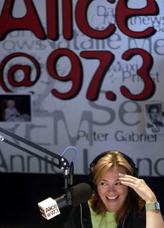 John Green/staff 8/25/05 smc times cue Sarah,one of  DJ's on The Sarah/No Name Show ,on Alice 97.3 in San Francisco