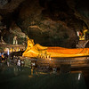 "the reclining Buddha in Wat Tham Suwan Khuha or, ""The Monkey Cave"", stretches to nearly 50 feet (15 meters) in length"