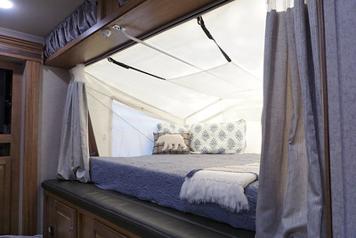 I know it's hard to tell but each wall of the tent over the bed unzips, allowing you to have a 360 degree view where ever you're camped.