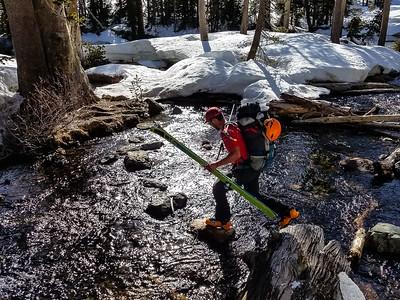 Danny crossing stream