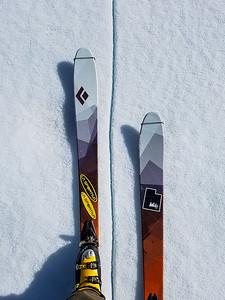 skis over crack in frozen lake