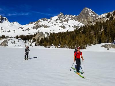 skiing across Ediza Lake below Mt Ritter
