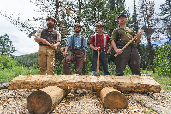 The staff at Pueblo stand in front of the first railroad tie build by a Philmont program camp. Photo by Alexander Bohlen